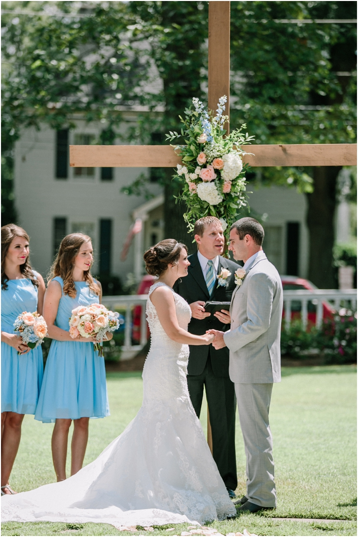 Outdoor Wedding Ceremony with Cross Backdrop